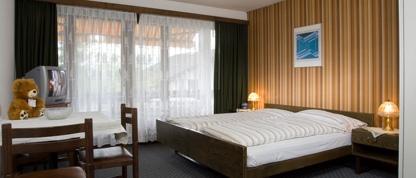 Hotel Bernerhof, Wengen, Bernese Oberland, Switzerland - double bedroom interior.jpg